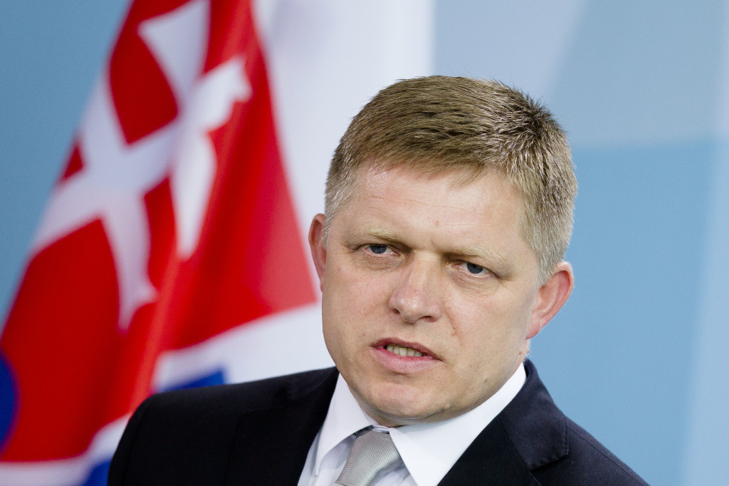 The Prime Minister of Slovakia Robert Fico reacts during a news conference with German Chancellor Angela Merkel, unseen, after a meeting at the chancellery in Berlin, Tuesday, July 3, 2012. Slovakia's Prime Minister says the public's patience for further European rescue measures has ran out unless the eurozone's  troubled nations do their homework and get their finances in order. (AP Photo/Markus Schreiber)