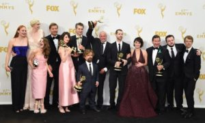 "(FILES): This file photo taken on September 20, 2015 shows winners of the award for Outstanding Drama Series for 'Game of Thrones' as they pose in the Press Room during the 67th Emmy Awards in Los Angeles, California. From left are: actors Sophie Turner, Gwendoline Christie, Maisie Williams, Nikolaj Coster-Waldau, Carice van Houten, writer/director David Benioff, actors Peter Dinklage, Conleth Hill, writer/director D.B. Weiss, actress Lena Headey, director David Nutter, actors John Bradley and Alfie Allen. Hollywood begins the long run-up to its annual prizegiving season July 14, 2016 as the television industry finds out who made the cut at the announcement of the 2016 Emmy Awards nominations. HBO's fantasy epic ""Game of Thrones"" is expected to dominate the nods after raking in a record-breaking 12 awards last year, including best drama series. / AFP PHOTO / VALERIE MACON"